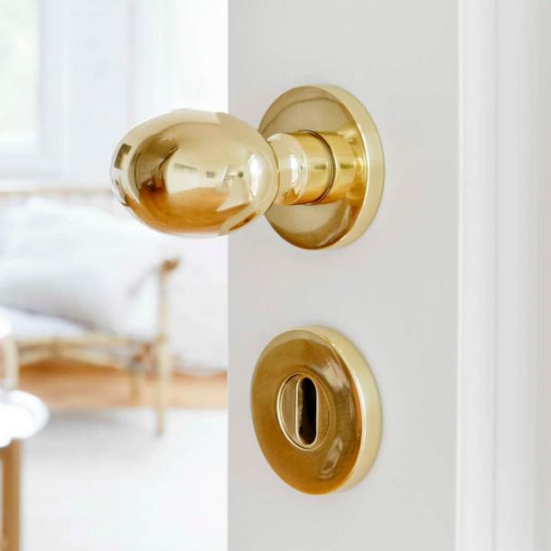 Habo dörrhandtag inuti med nyckelplatta mässing (1006)